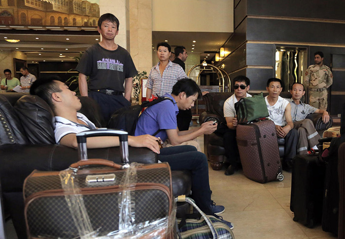 Chinese workers await evacuation from Baghdad, Iraq.